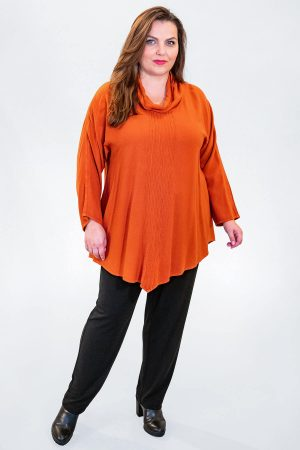 The model in this photo is wearing a cowl neck sousdi tunic from Angel Circle with Robell Elena skinny jeans in black