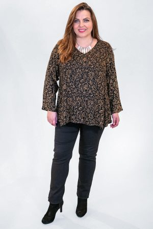 The model in this photo is wearing a short v neck top from Angel Circle at Bakou