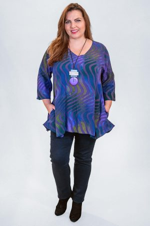 The model in this photo is wearing a v neck top with pockets from Angel Circle available in plus sizes from Bakou in London