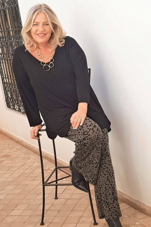 This model is wearing super stretchy and comfortable Kasbah Clothing Priya jersey trousers in black and white animal print