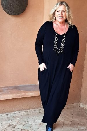 A simple but stylish jersey dress with v neck and pockets by Kasbah Clothing