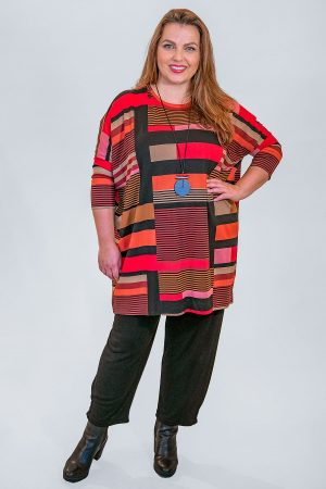 The model in this photo is wearing a chilli red geometric print Gabini jersey tunic from Masai with Masai Patti harem trousers from Bakou