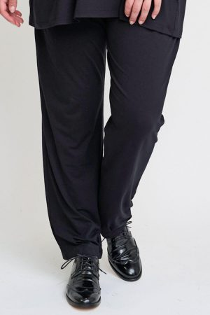 The model in this photo is wearing a pair of Eda black jersey harem trousers by Pont Neuf from sizes 14-28
