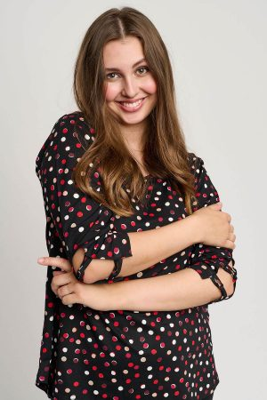 This model is wearing a Pont Neuf Melly top with red and white spots available in plus sizes from Bakou