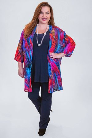 The model in this photo is wearing a dazzling multicoloured jacket by Q'neel