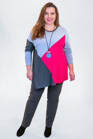 The model in this photo is wearing a strikng jumper in block pattern from Verpass available in plus sizes from Bakou